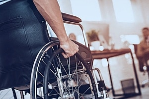 a man in a wheelchair who is going to see an attorney after his injury