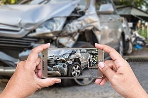 a man who was injured in a car accident taking pictures