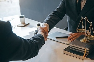 an attorney shaking hands with a personal injury client