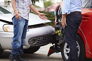 two individuals in a car accident where a passenger was injured