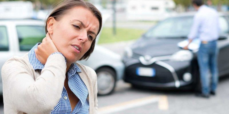 woman injured in a car accident requiring representation from a personal injury attorney