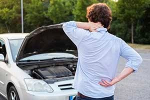 a man in pain from car accident that needs a personal injury attorney