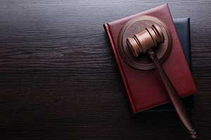gavel on top of consumer fraud law books
