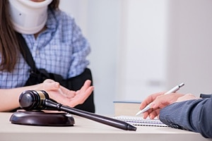 a woman speaking to an attorney after learning what to look for in a personal injury attorney