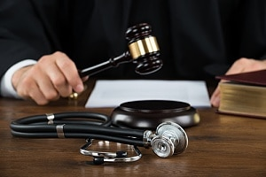Judge with gavel and stethoscope