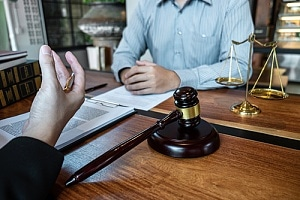 Wrongful death attorney talking to client