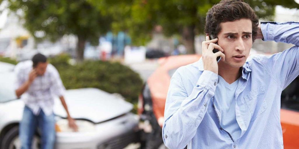 Man calling his attorney asking can I sue the person who hit my car