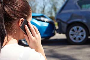 Woman involved in a car accident calling her Santa Fe personal injury attorney