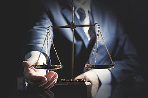 A weigh scale and a person in suit. Not all injury attorneys are well-versed in dog bite cases