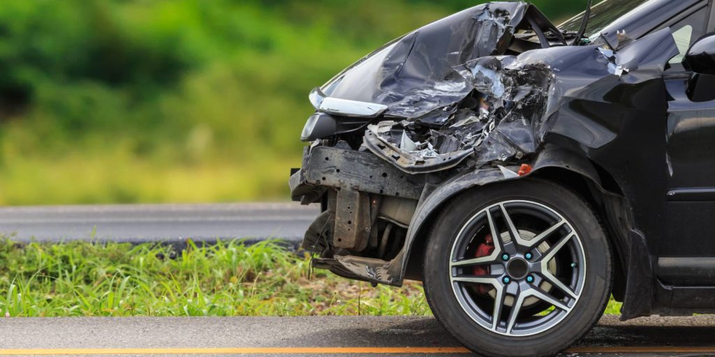 Damaged car after a road accident. There are limitations on personal injury claims arising from automobile accidents
