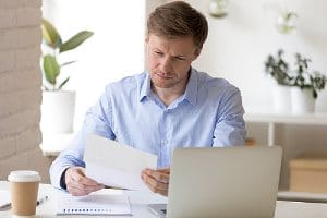 Employer looking through racial discrimination lawsuit notification from an employee