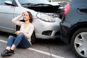 Injured girl after car accident in a street. You are liable for your medical bills