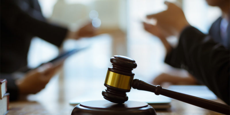 an attorney and client engage in a conversation about the personal injury case