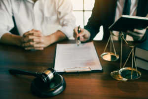 attorney and his client go over their personal injury case