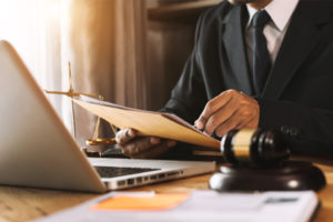 attorney marks error while proofreading clients demand letter