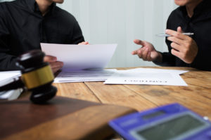 client meets with attorney to discuss the overbilling scheme lawsuit