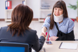 client meets with her lawyer to discuss the personal injury case