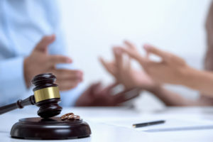 lawyer and client have a conversation about the client case regarding the car accident