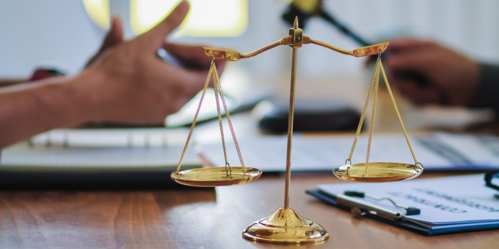 lawyer and judge go over the settlement of the personal injury case