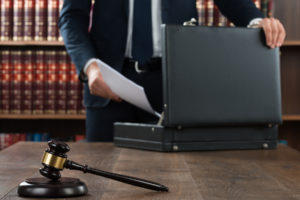 lawyer packs up suitcase after working on a personal injury case