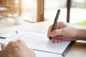 person signs document that is used in personal injury case along with the demand letter