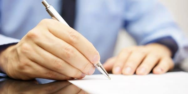 Expert professional drafting a settlement letter for a car accident