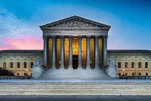Illuminated United States Supreme Court building. The Civil Rights Act of 1964 clearly defined racial discrimination