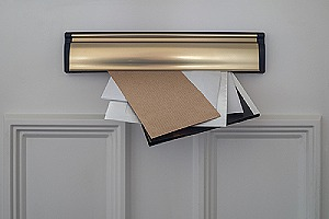 Letters posted through a letterbox. There are key steps to write a settlement letter for a car accident