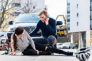 Passerby helping a car accident victim. Medical records can also be used to back up claims in the settlement letter