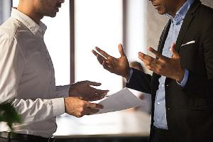 Two employees arguing at workplace. Racially discriminated victims have several things that they can do